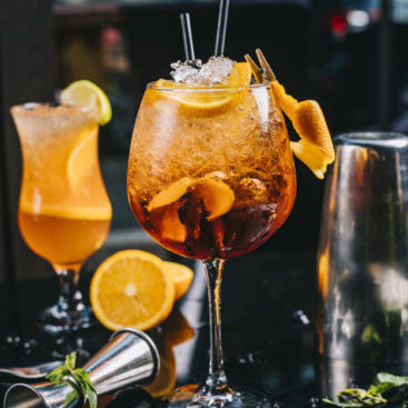 cocktail topped with orange slice